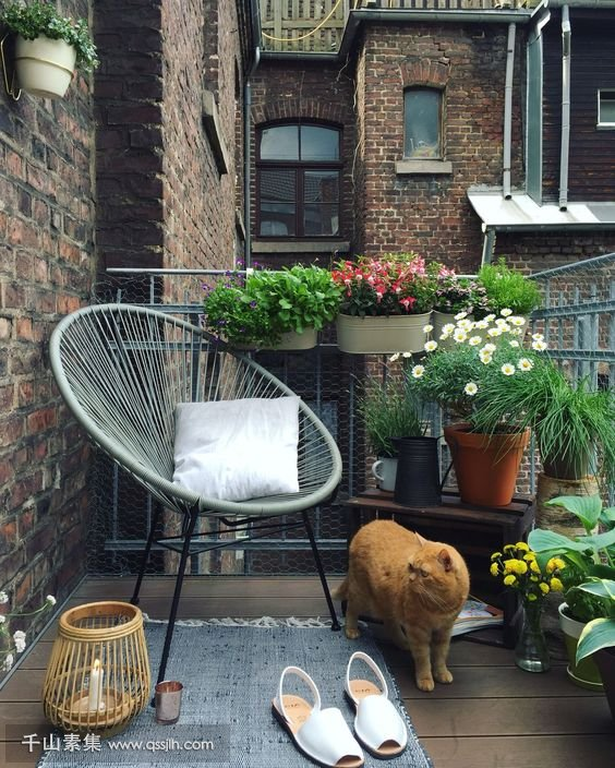 22-a-summer-balcony-with-potted-greenery-and-blooms-a-chair-a-rug-and-candles.jpg
