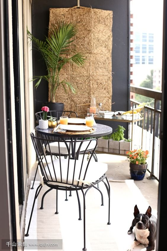 12-a-round-table-comfy-forged-chairs-a-stand-with-plants-and-dishes-on-top-a-jute-hanging-on-the-wall.jpg