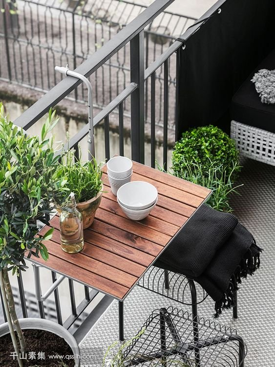 10-a-hanging-table-metal-chairs-and-a-wicker-seat-plus-potted-greenery-for-a-lively-modern-look.jpg