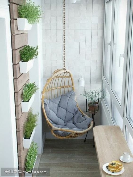 09-a-hanging-chair-wall-mounted-planters-a-folding-table-for-having-meals.jpg