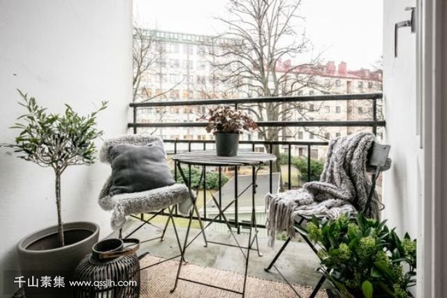 08-a-small-balcony-with-folding-furniture-potted-greenery-and-candles-for-having-meals.jpg