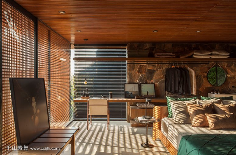 03-The-master-bedroom-is-done-with-wooden-screens-stone-wood-and-leather-and-theres-an-open-storage-space-775x510.jpg