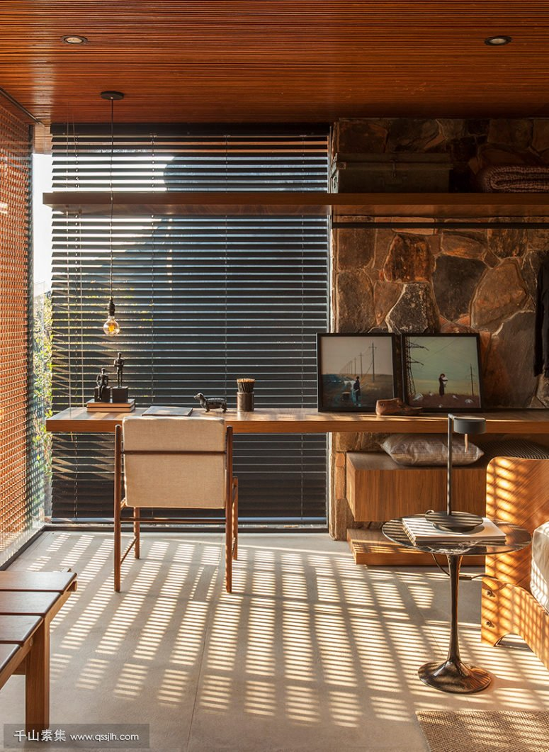 05-The-home-office-is-located-in-the-bedroom-theres-a-wall-mounted-desk-next-to-the-window-775x1061.jpg