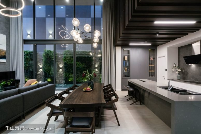 03-The-dining-area-is-next-to-the-minimalist-kitchen-775x517.jpg