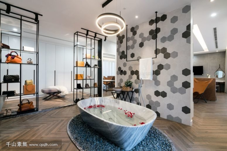 04-The-master-suite-features-a-free-standing-stone-tub-separated-from-the-sleeping-space-775x517.jpg
