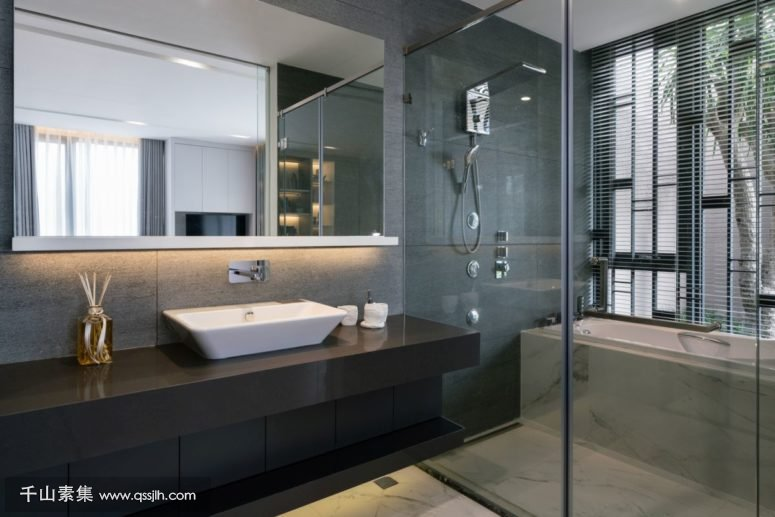 09-The-bathrooms-are-open-and-airy-done-in-modern-style-with-large-mirrors-775x517.jpg