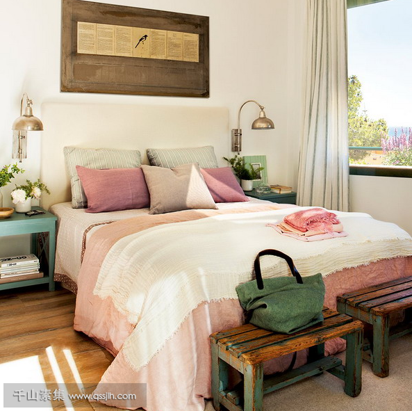 04-The-master-bedroom-is-furnished-with-shabby-chic-and-vintage-items-and-the-color-palette-is-a-pastel-one-the-views-are-also-present.png